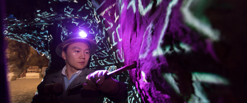 "Environmental portraits of Jaewoo Lee ""data mining"" in a gold mine."