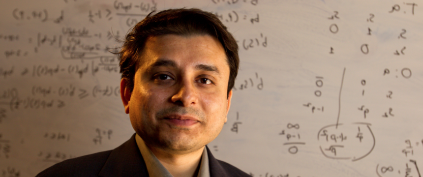 Environmental portrait of Creative 研究 Medal winner Prashant Doshi with mathematical equations on white board in background