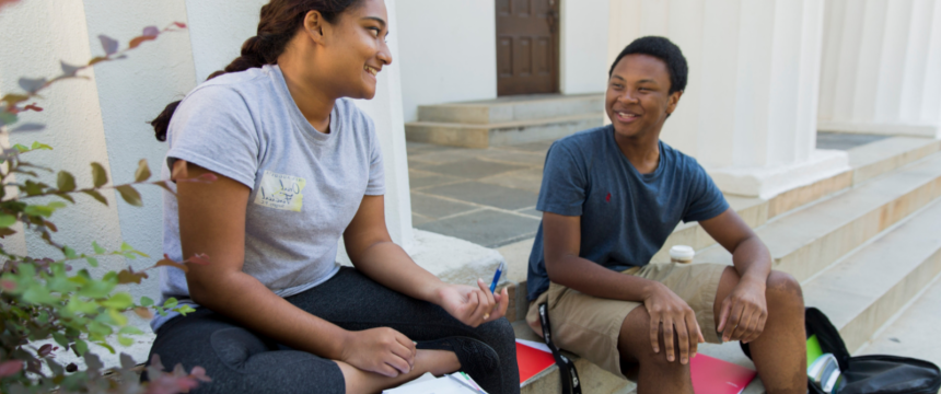 国际 affairs and arabic double major Jailen Gary, left, and social work and sociology major Reeya Hoosain both of Grovetown, Ga study together for an Arabic Test on the steps of the Chapel on a fall day.