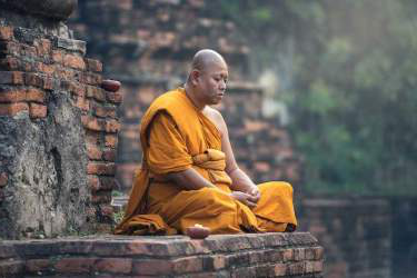 photo of a monk in meditation